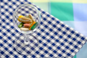 wine glass with pills